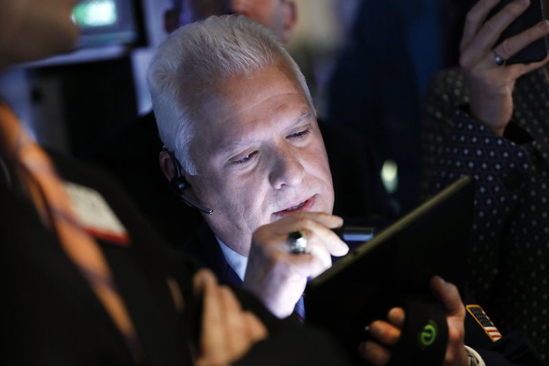 Trader Peter Castelli works on the floor of the New York Stock Exchange, Thursday, April 11, 2019. U. (AP Photo/Richard Drew)