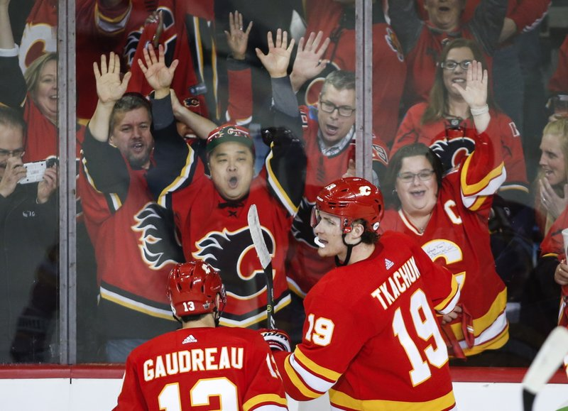 Calgary Flames' Matthew Tkachuk, right, celebrates his goal against the Colorado Avalanche during the second period of Game 1 in an NHL hockey first-round playoff series Thursday, April 11, 2019, in Calgary, Alberta. (Jeff McIntosh/The Canadian Press via AP)