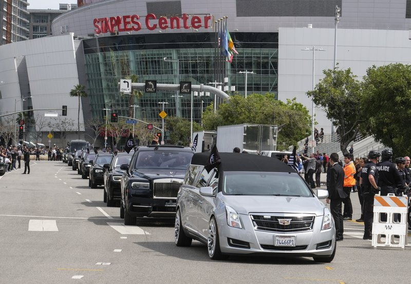 The hearse carrying rapper Nipsey Hussle leaves Staples Center after a memorial service in Los Angeles, Thursday, April 11, 2019. (AP Photo/Ringo H.W. Chiu)