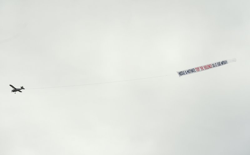 A plane carrying a banner reading