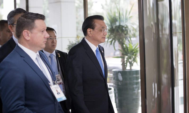 China's Prime Minister Li Keqiang, center, arrives at the Summit of Central and Eastern Europe and China in Dubrovnik, Croatia, Friday, April 12, 2019. (AP Photo/Darko Bandic)