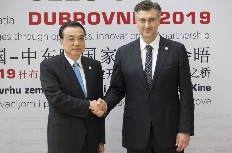 Croatia's Prime Minister Andrej Plenkovic, right, welcomes his Chinese counterpart Li Keqiang at the Summit of Central and Eastern Europe and China in Dubrovnik, Croatia, Friday, April 12, 2019. (AP Photo/Darko Bandic)