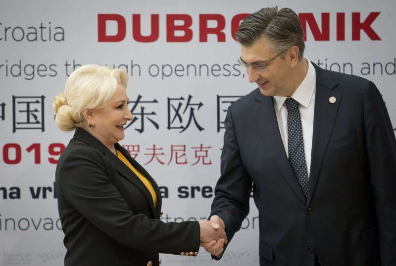 Croatia's Prime Minister Andrej Plenkovic, right, welcomes his Romanian counterpart Viorica Dancila at the Summit of Central and Eastern Europe and China in Dubrovnik, Croatia, Friday, April 12, 2019. (AP Photo/Darko Bandic)