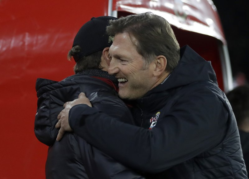 Southampton's manager Ralph Hasenhuttl, right, hugs the Liverpool's manager Juergen Klopp before the English Premier League soccer match between Southampton and Liverpool at St Mary's stadium in Southampton, England Friday, April 5, 2019. (AP Photo/Kirsty Wigglesworth)