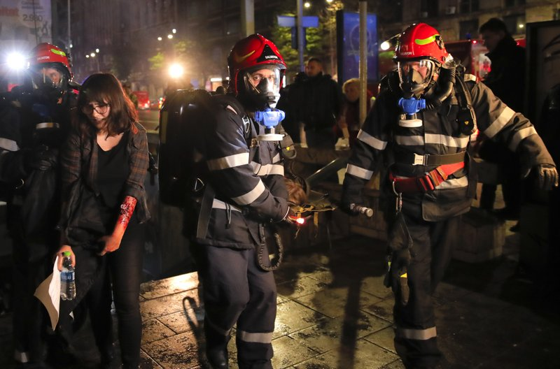 Emergency workers evacuate volunteers posing as victims during a rescue exercise in Bucharest, Romania, early Friday, April 12, 2019. (AP Photo/Vadim Ghirda)