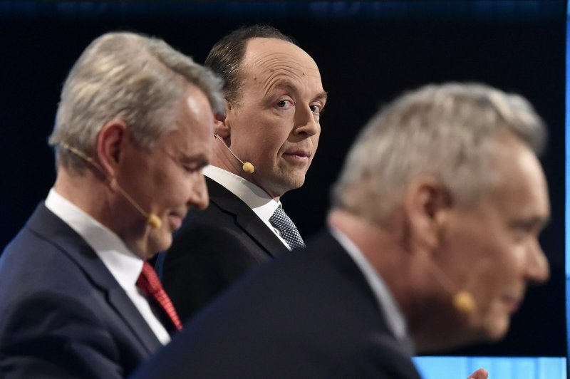 From left, Green Party chairman Pekka Haavisto, Finns Party chairman Jussi Halla-aho and Social Democratic Party chairman Antti Rinne, chairman at the party leaders' parliamentary elections debate, arranged by Finnish Broadcasting Company Yle in Helsinki, Finland, on Thursday, April 11, 2019. (Jussi Nukari/Lehtikuva via AP)