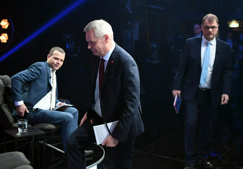 Party leaders gathered for the Prime Minister debate organized by tv- channel MTV 3 on April 2nd, 2019 in Helsinki . (sitting ) Petteri Orpo of the National Coalition Party, Antti Rinne of the Finnish Social Democratic Party and Juha Sipil' of the Centre Party of Finland. Finns are voting upcoming Sunday April 14, in parliamentary elections dominated by anxieties over climate change and how to preserve their generous welfare model while having one of the world's most rapidly ageing populations. (Jussi Nukari/Lehtikuva via AP)
