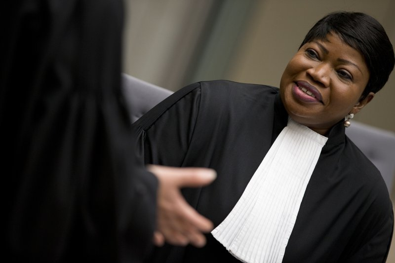 -FILE- In this Wednesday, April 4, 2018 image, chief prosecutor Fatou Bensouda waits for alleged jihadist leader Al Hassan Ag Abdoul Aziz Ag Mohamed Ag Mahmoud to enter the court room at the International Criminal Court in The Hague, Netherlands. (AP Photo/Peter Dejong, Pool)