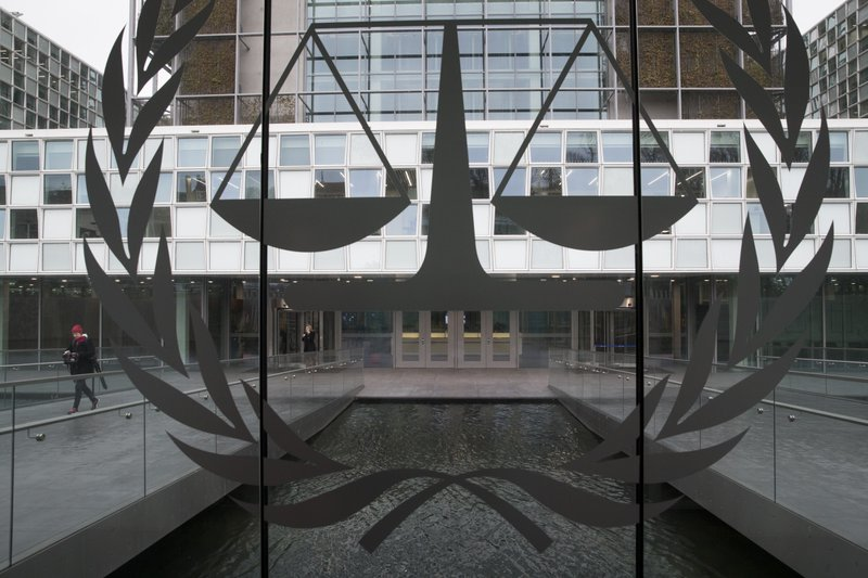 In this Wednesday Jan. 16, 2019, image, a person leaves the International Criminal Court in The Hague, Netherlands. (AP Photo/Peter Dejong)