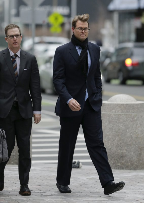 Mark Riddell, right, arrives at federal court Friday, April 12, 2019, in Boston, where he was scheduled to plead guilty to charges in a nationwide college admissions bribery scandal. (AP Photo/Charles Krupa)