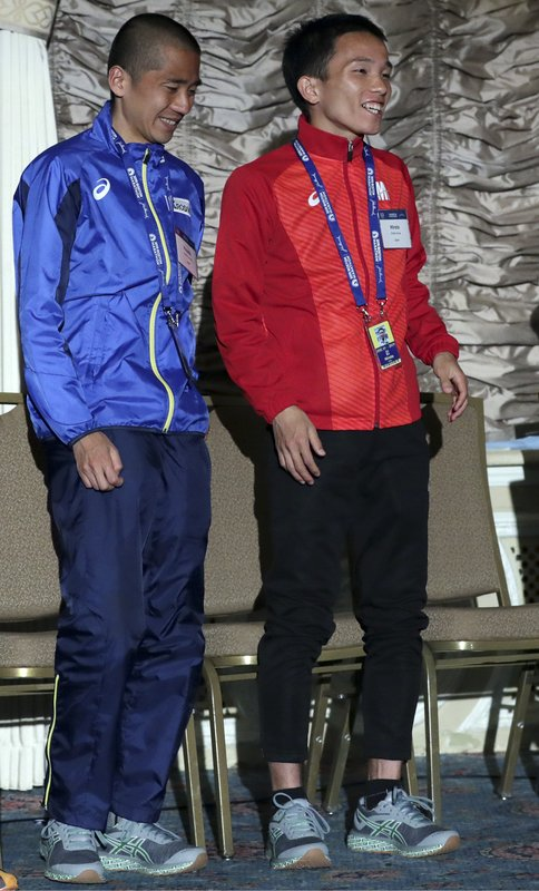 Hayato Sonoda, left, and Hiroto Inoue, both of Japan, stand on the stage during a media availability on Friday, April 12, 2019, in Boston in advance of the 123rd Boston Marathon on Monday. (AP Photo/Charles Krupa)