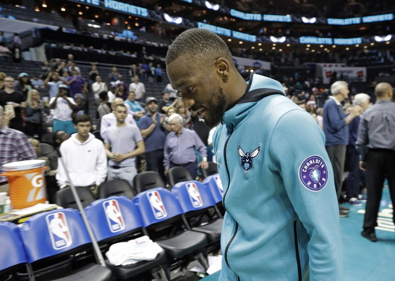Charlotte Hornets' Kemba Walker eaves the court after the team's NBA basketball game against the Orlando Magic in Charlotte, N. (AP Photo/Chuck Burton)