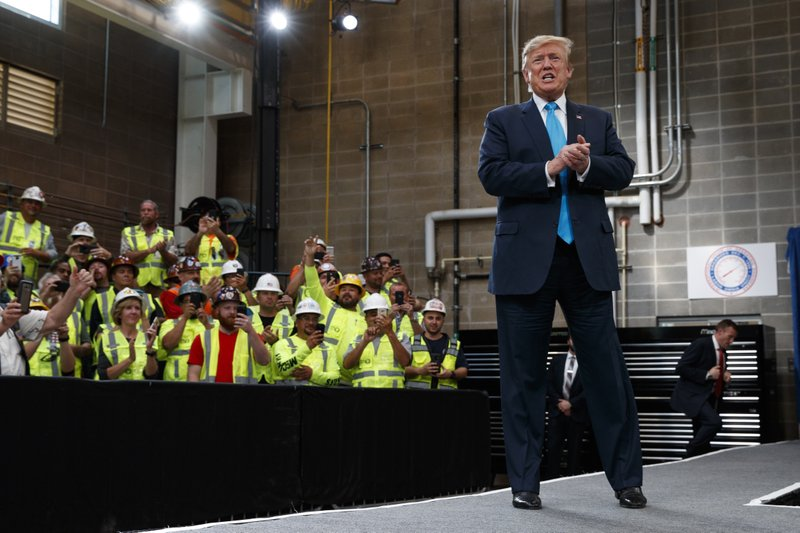 President Donald Trump arrives to speak about energy and infrastructure at the International Union of Operating Engineers International Training and Education Center, Wednesday, April 10, 2019, in Crosby, Texas. (AP Photo/Evan Vucci)