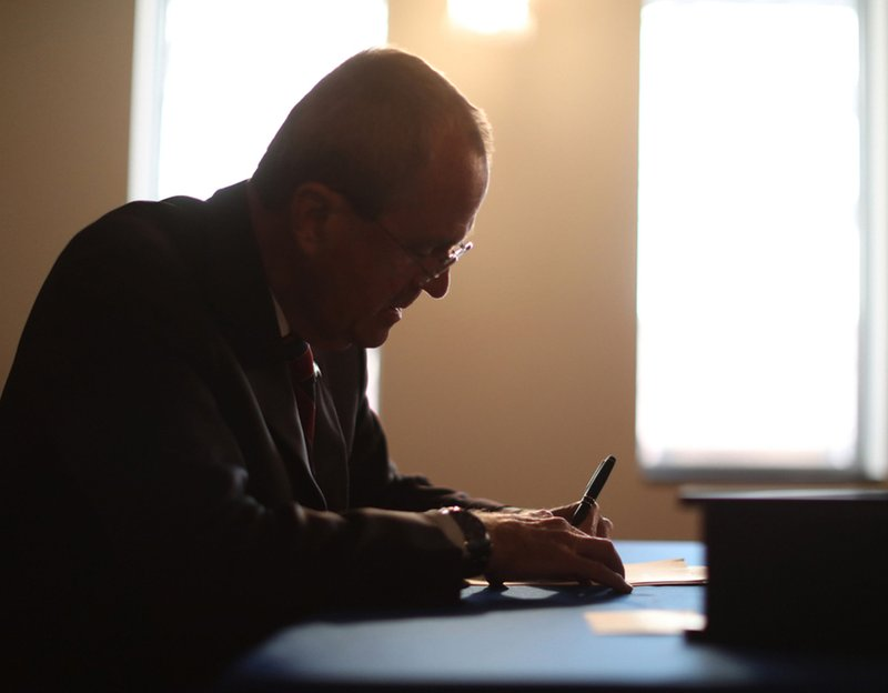 In this photo provided by the New Jersey Office of the Governor, N.J. Gov. Phil Murphy signs the Medical Aid in Dying for the Terminally Ill Act Friday, April 12, 2019 at the New Jersey Statehouse in Trenton, N. (New Jersey Office of the Governor via AP)