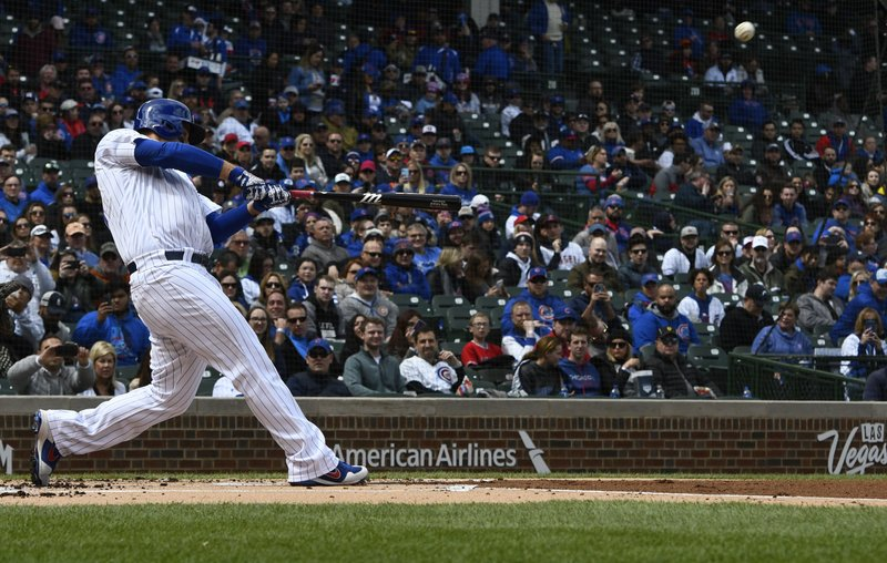Chicago Cubs' Anthony Rizzo hits a two run home run during the first inning of a baseball game against the Los Angeles Angels Friday, April 12, 2019, in Chicago. (AP Photo/Matt Marton)