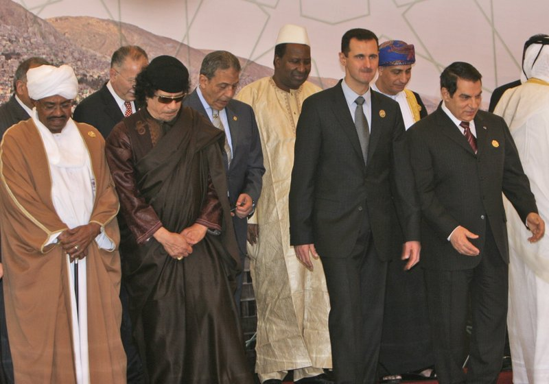 FILE - In this Saturday, March 29, 2008 file photo, Front, from left, Sudanese President Omar Al-Bashir, Libyan leader Moammar Gadhafi, Syrian President Bashar Assad, Tunisian President Zine El Abidine Ben Ali, stand during the opening session of the Arab Summit in Damascus, Syria. (AP Photo/Adel Hana, File)