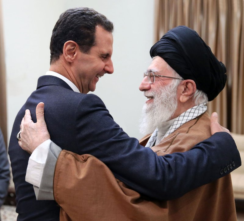 In this February 25, 2019 file photo, picture released by an official website of the office of the Iranian supreme leader, Supreme Leader Ayatollah Ali Khamenei, right, welcomes Syrian President Bashar Assad in Tehran, Iran. (Office of the Iranian Supreme Leader via AP, File)