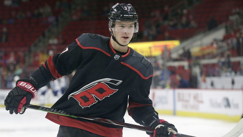 FILE - In this March 8, 2019, file photo, Carolina Hurricanes' Andrei Svechnikov (37) warms up prior to an NHL hockey game against the Winnipeg Jets, in Raleigh, N. (AP Photo/Gerry Broome, File)