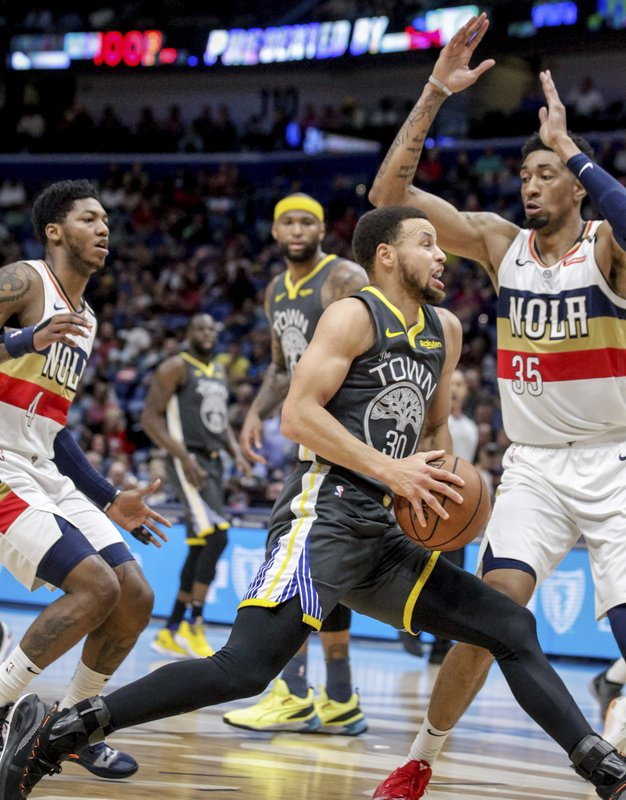 Golden State Warriors guard Stephen Curry (30) drives against New Orleans Pelicans forward Christian Wood (35) in the first half of an NBA basketball game in New Orleans, Tuesday, April 9, 2019. (AP Photo/Scott Threlkeld)