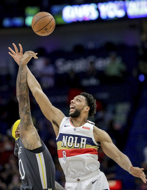 New Orleans Pelicans center Jahlil Okafor (8) and Golden State Warriors center DeMarcus Cousins (0) battle for a rebound in the first half of an NBA basketball game in New Orleans, Tuesday, April 9, 2019. (AP Photo/Scott Threlkeld)