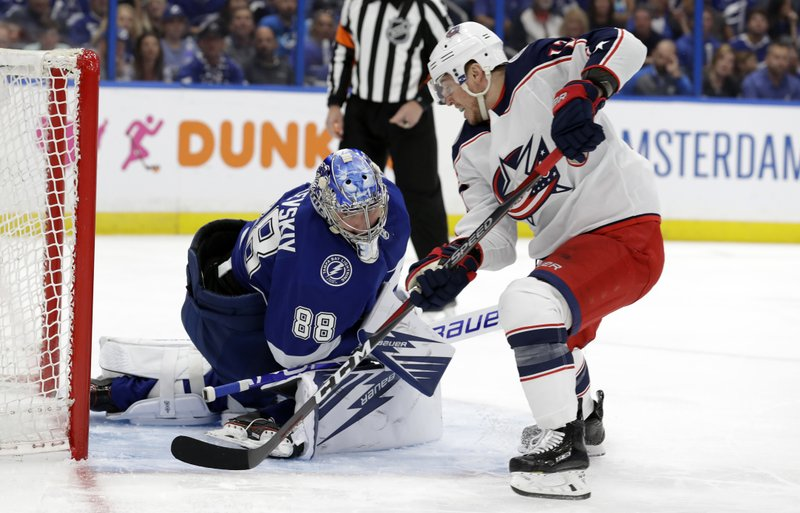 Columbus Blue Jackets right wing Cam Atkinson (13) scores around Tampa Bay Lightning goaltender Andrei Vasilevskiy (88) during the first period of Game 2 of an NHL Eastern Conference first-round hockey playoff series Friday, April 12, 2019, in Tampa, Fla. (AP Photo/Chris O'Meara)