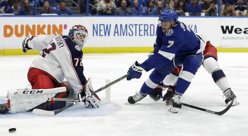 Columbus Blue Jackets goaltender Sergei Bobrovsky (72) makes a save on a shot by Tampa Bay Lightning right wing Mathieu Joseph (7) during the second period of Game 2 of an NHL Eastern Conference first-round hockey playoff series Friday, April 12, 2019, in Tampa, Fla. (AP Photo/Chris O'Meara)