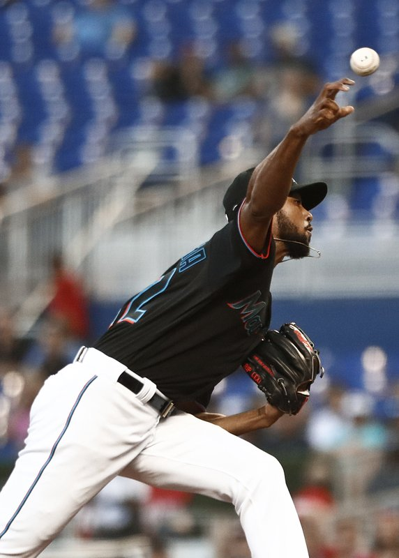 Miami Marlins starting pitcher Sandy Alcantara (22) delivers during the first inning of the team's baseball game against the Philadelphia Phillies on Friday, April 12, 2019, in Miami. (AP Photo/Brynn Anderson)