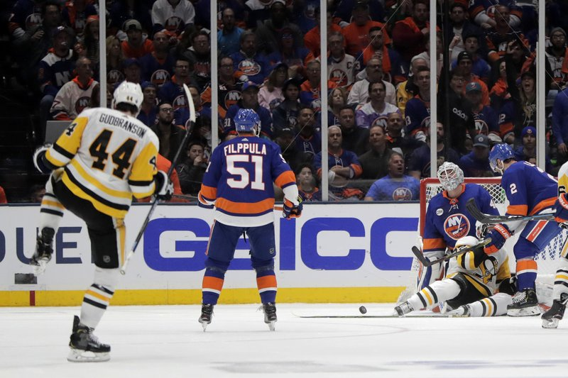 New York Islanders goaltender Robin Lehner, of Sweden, reacts as Pittsburgh Penguins defenseman Erik Gudbranson (44) celebrates his goal during the second period of Game 2 of an NHL hockey first-round playoff series Friday, April 12, 2019, in Uniondale, N. (AP Photo/Julio Cortez)