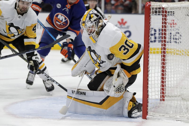 Pittsburgh Penguins goaltender Matt Murray blocks a shot from the New York Islanders during the second period of Game 2 of an NHL hockey first-round playoff series Friday, April 12, 2019, in Uniondale, N. (AP Photo/Julio Cortez)