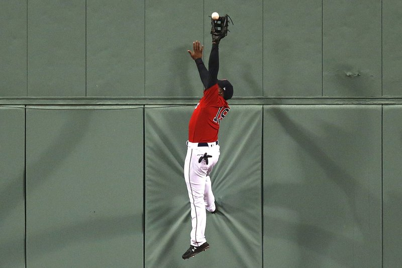 Boston Red Sox's Jackie Bradley Jr. makes the catch a fly-out by Baltimore Orioles' Joey Rickard during the eighth inning of a baseball game in Boston, Friday, April, 12, 2019. (AP Photo/Michael Dwyer)