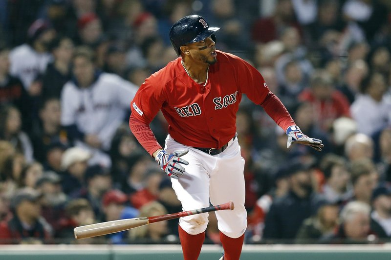 Boston Red Sox's Xander Bogaerts watches his RBI-double during the fourth inning of a baseball game against the Baltimore Orioles in Boston, Friday, April, 12, 2019. (AP Photo/Michael Dwyer)