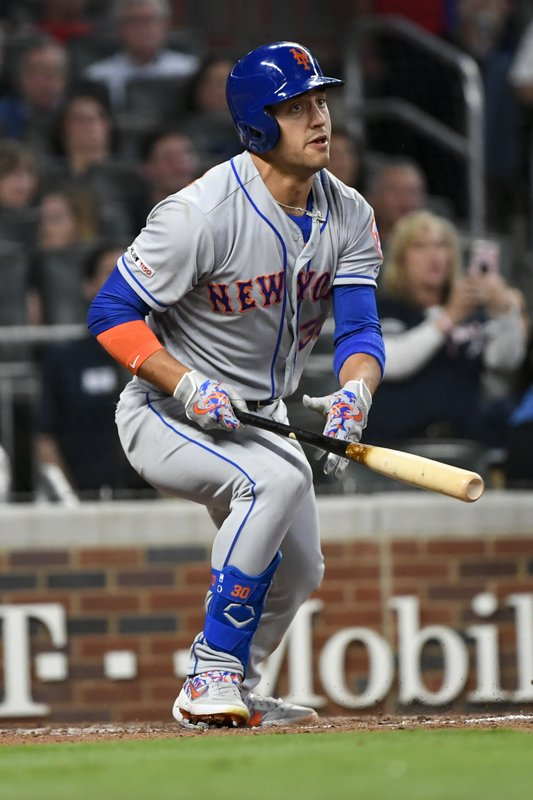 New York Mets right fielder Michael Conforto watches his one-run double to right field during the fourth inning of a baseball game against the Atlanta Braves, Friday, April 12, 2019, in Atlanta. (AP Photo/John Amis)