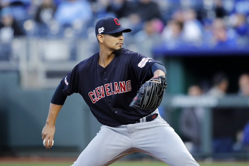 Cleveland Indians pitcher Carlos Carrasco throws to a Kansas City Royals batter in the first inning of a baseball game at Kauffman Stadium in Kansas City, Mo. (AP Photo/Colin E. Braley)