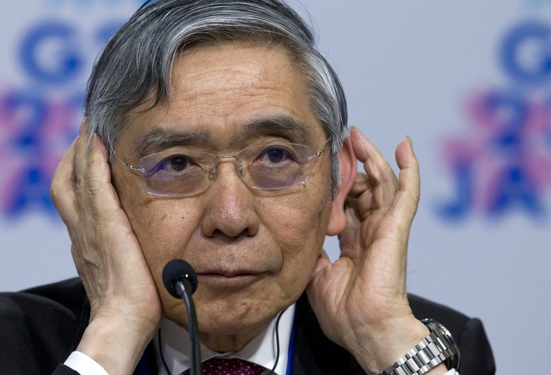 Bank of Japan Governor Haruhiko Kuroda, listen a question during a G20 news conference, at the World Bank/IMF Spring Meetings in Washington, Friday, April 12, 2019. (AP Photo/Jose Luis Magana)