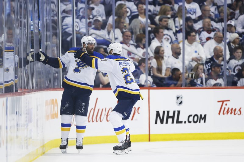 St. Louis Blues left wing Pat Maroon (7) celebrates with Alex Pietrangelo (27) after Maroon's goal against the Winnipeg Jets during the second period of Game 2 of an NHL hockey first-round playoff series Friday, April 12, 2019, in Winnipeg, Manitoba. (John Woods/The Canadian Press via AP)