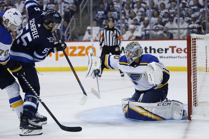Winnipeg Jets centre Mark Scheifele (55) is stopped St. Louis Blues goaltender Jordan Binnington (50) during the second period of Game 2 of an NHL hockey first-round playoff series Friday, April 12, 2019, in Winnipeg, Manitoba. (John Woods/The Canadian Press via AP)
