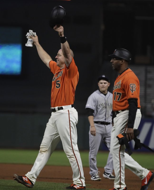 San Francisco Giants' Erik Kratz (5) celebrates at the end of an 18 inning baseball game against the Colorado Rockies Saturday, April 13, 2019, in San Francisco. (AP Photo/Ben Margot)