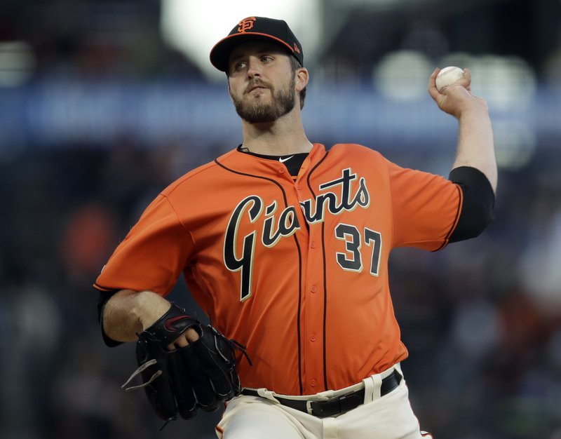 San Francisco Giants pitcher Drew Pomeranz works against the Colorado Rockies during the first inning of a baseball game Friday, April 12, 2019, in San Francisco. (AP Photo/Ben Margot)