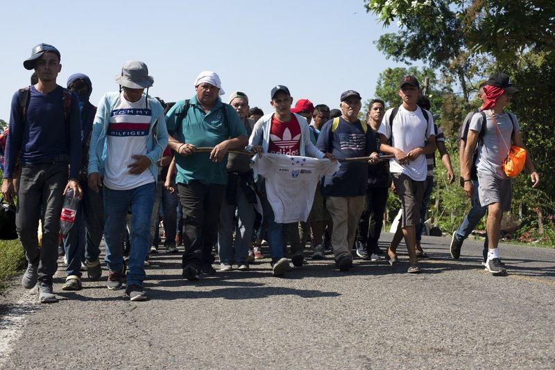 Central American migrants, part of a caravan hoping to reach the U.S. border, walk on a road in Frontera Hidalgo, Mexico, Friday, April 12, 2019. (AP Photo/Isabel Mateos)