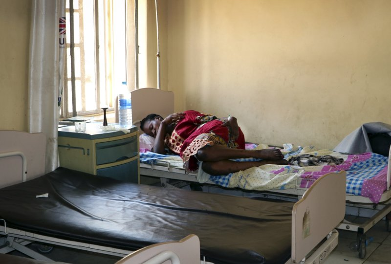 In this photo taken Monday, March 11, 2019, a pregnant woman lies on a bed in the maternity ward of the Juba Teaching Hospital, in the capital Juba, South Sudan. (AP Photo/Sam Mednick)