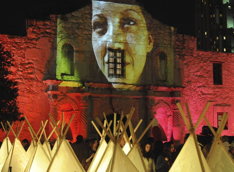 In this March 14, 2009 photo, a video showing indigenous and Mestizo people of Texas is projected on the Alamo shrine during