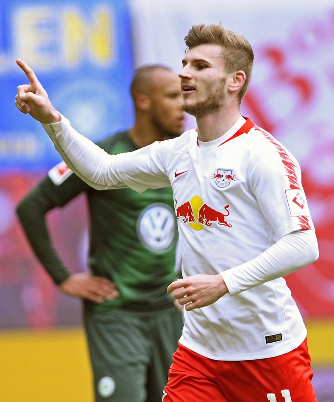 Leipzig's Timo Werner, right, celebrates after scoring his side's 2nd goal during the German Bundesliga soccer match between RB Leipzig and VfL Wolfsburg in Leipzig, Germany, Saturday, April 13, 2019. (AP Photo/Jens Meyer)