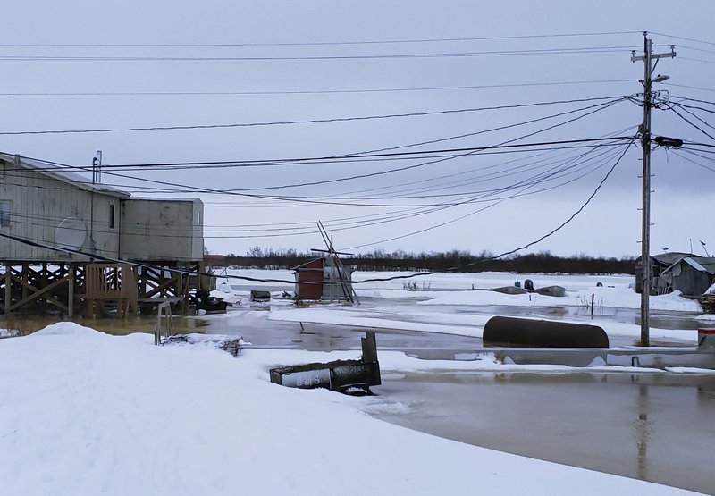 In this Feb. 12, 2019 photo provided by Philomena Keys, high water pushed up the Yukon River from the Bering Sea floods yards around homes in the western village of Kotlik, Alaska. (Philomena Keys via AP)