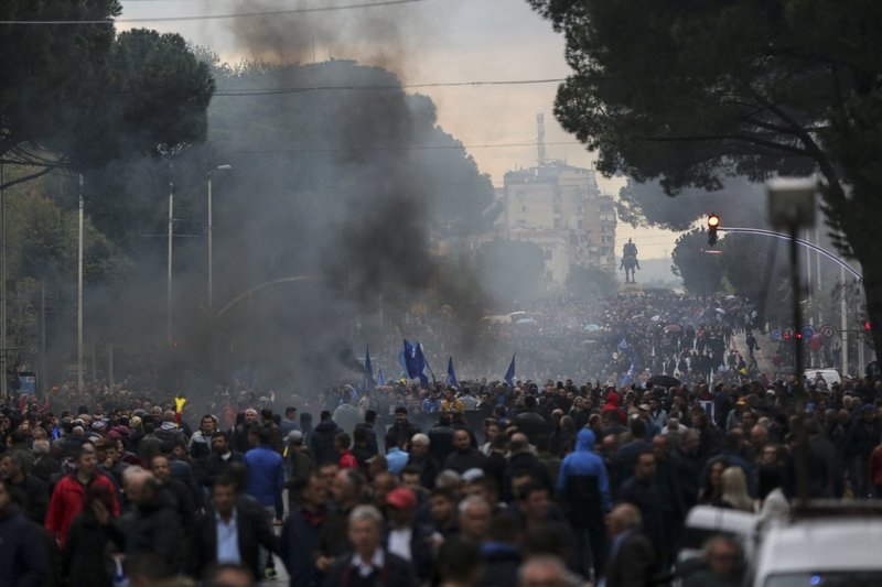Protesters take part in an anti-government protest in Tirana, Albania, Saturday, April 13, 2019. Albanian opposition parties have returned to the streets for the first time since mid-February calling for the government's resignation and an early election, as the center-right opposition accuses the leftist Socialist Party government of Prime Minister Edi Rama of corruption and links to organized crime, which the government denies. (AP Photo/Visar Kryeziu)