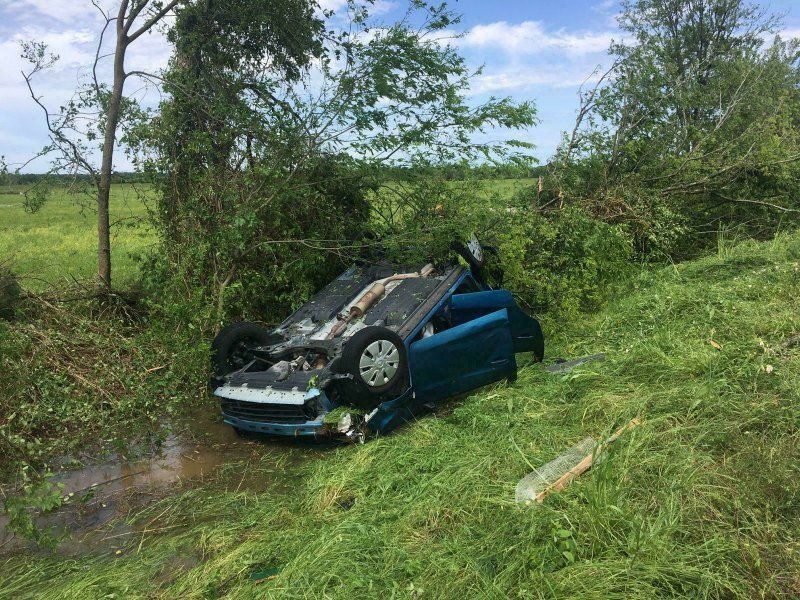A car lies upside down in a ditch following a suspected tornado, Saturday, April 13, 2019 in Franklin, Texas. (Laura McKenzie/College Station Eagle via AP)