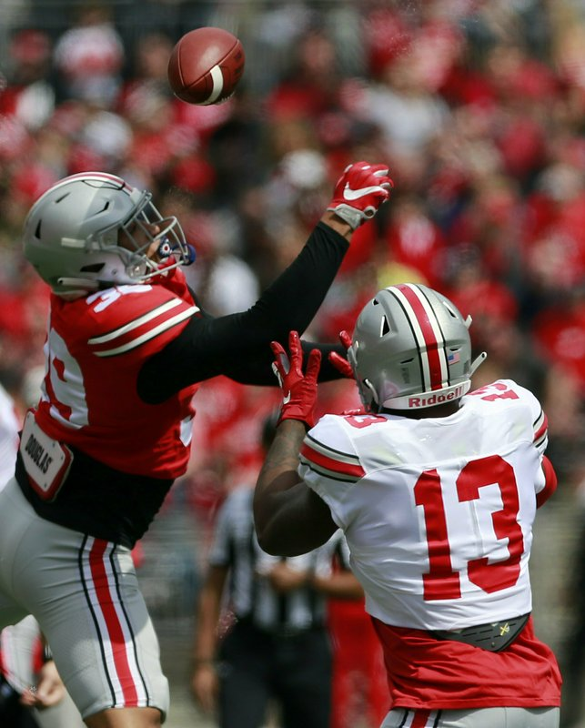 Ohio State's Malik Harrison (39) blocks a pass intended for Tyreke Johnson (13)  during the spring NCAA college football game at the Ohio Stadium in Columbus, Ohio, Saturday April 13, 2019. (Brooke LaValley/The Columbus Dispatch via AP)