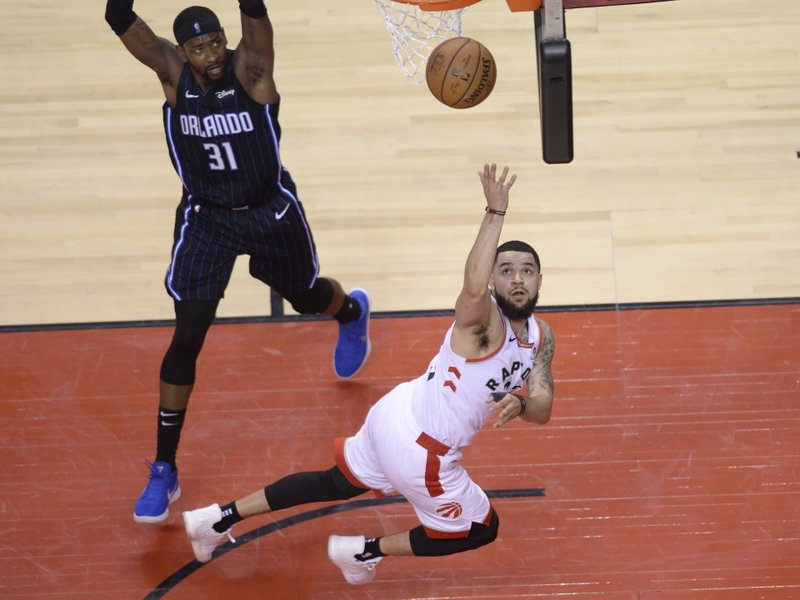 Toronto Raptors guard Fred VanVleet (23) makes a basket as Orlando Magic guard Terrence Ross (31) looks on during the second half in Game 1 of a first-round NBA basketball playoff series in Toronto, Saturday, April 13, 2019. (Nathan Denette/The Canadian Press via AP)