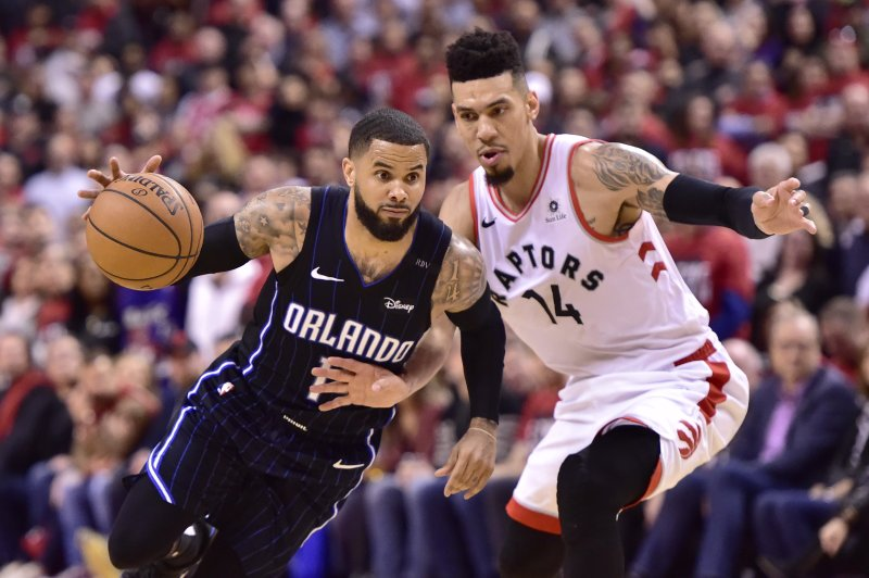 Orlando Magic guard D.J. Augustin (14) drives around Toronto Raptors guard Danny Green (14) during the second half in Game 1 of a first-round NBA basketball playoff series in Toronto, Saturday, April 13, 2019. (Frank Gunn/The Canadian Press via AP)