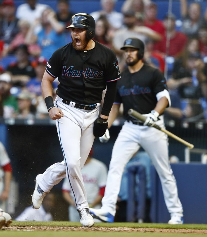 Miami Marlins' Austin Dean (44) reacts after scoring during the second inning of the team's baseball game against the Philadelphia Phillies on Saturday, April 13, 2019, in Miami. (AP Photo/Brynn Anderson)