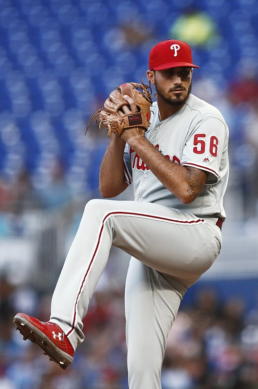 Philadelphia Phillies starting pitcher Zach Eflin winds up during the first inning of the team's baseball game against the Miami Marlins on Saturday, April 13, 2019, in Miami. (AP Photo/Brynn Anderson)